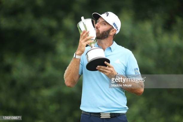 Dustin Johnson of the United States poses with the trophy after winning the Travelers Championship at TPC River Highlands on June 28, 2020 in...