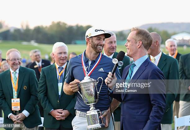 Dustin Johnson of the United States poses with the winner's trophy alongside Joe Buck of Fox Sports after winning the US Open at Oakmont Country Club...