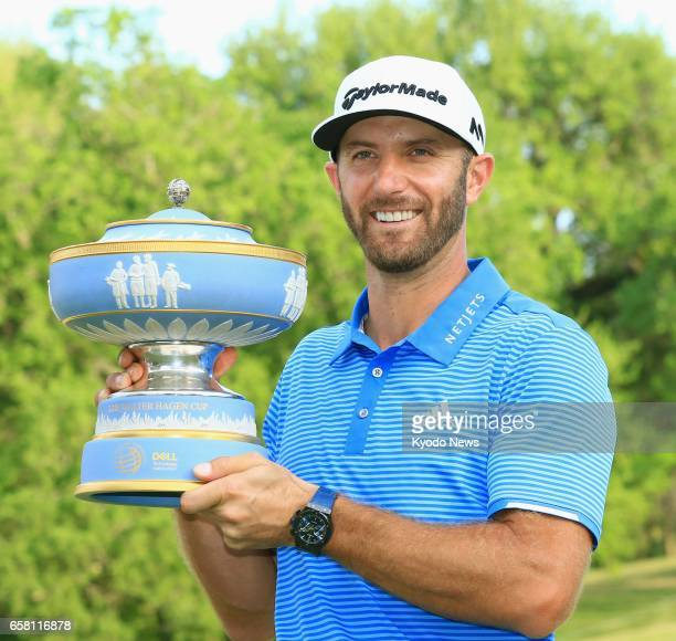 Dustin Johnson of the United States poses with the winner's trophy after his victory in the World Golf ChampionshipsDell Technologies Match Play...