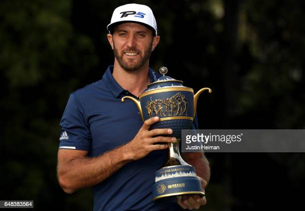 Dustin Johnson of the United States posese with his trophy after winning the World Golf Championships Mexico Championship at Club De Golf Chapultepec...
