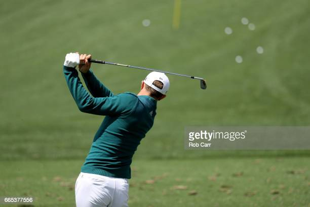 Dustin Johnson of the United States practices on the range prior to his tee time for the first round of the 2017 Masters Tournament at Augusta...