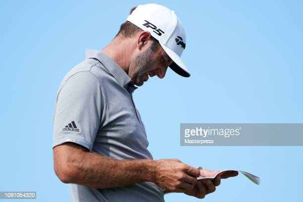 Dustin Johnson of the United States prepares a tee shot on the 10th hole during the final round of the Sentry Tournament of Champions at the...