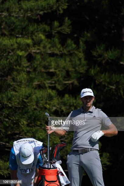 Dustin Johnson of the United States prepares for a tee shot on the 2nd hole during the final round of the Sentry Tournament of Champions at the...