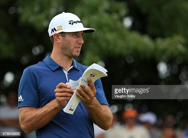 Dustin Johnson of the United States prepares to tee off on the first tee during the final round of the RBC Canadian Open at Glen Abbey Golf Club on...