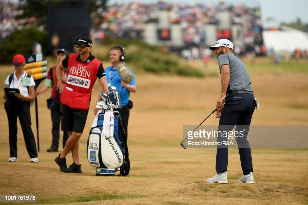 Dustin Johnson of the United States putts at the 4th hole during round one of the 147th Open Championship at Carnoustie Golf Club on July 19 2018 in...