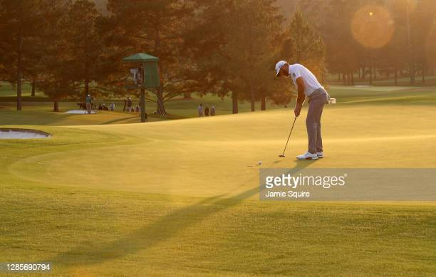 Dustin Johnson of the United States putts on the 18th green during the third round of the Masters at Augusta National Golf Club on November 14, 2020...