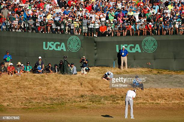 Dustin Johnson of the United States putts on the 18th green during the final round of the 115th US Open Championship at Chambers Bay on June 21 2015...