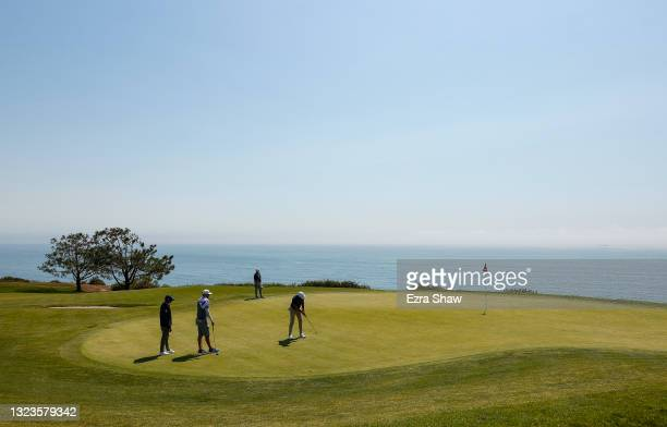Dustin Johnson of the United States putts on the fourth green during a practice round prior to the start of the 2021 U.S. Open at Torrey Pines Golf...