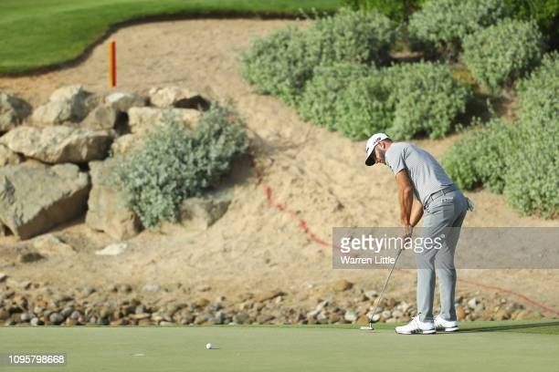 Dustin Johnson of the United States putts on the second green during Day Three of the Abu Dhabi HSBC Golf Championship at Abu Dhabi Golf Club on...