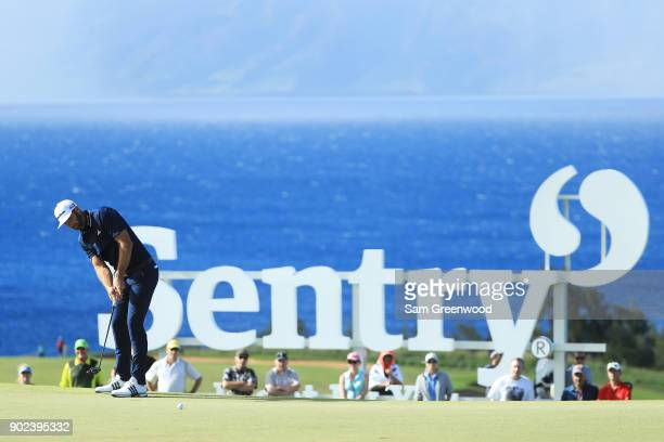 Dustin Johnson of the United States putts on the tenth green during the final round of the Sentry Tournament of Champions at Plantation Course at...