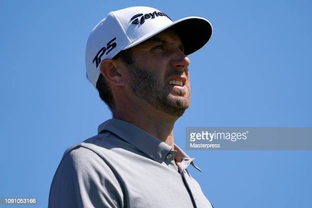 Dustin Johnson of the United States reacts after hitting a tee shot on the 2nd hole during the final round of the Sentry Tournament of Champions at...