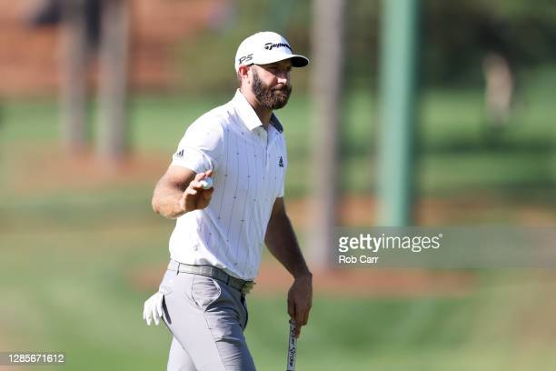 Dustin Johnson of the United States reacts after making a putt for birdie on the seventh green during the third round of the Masters at Augusta...