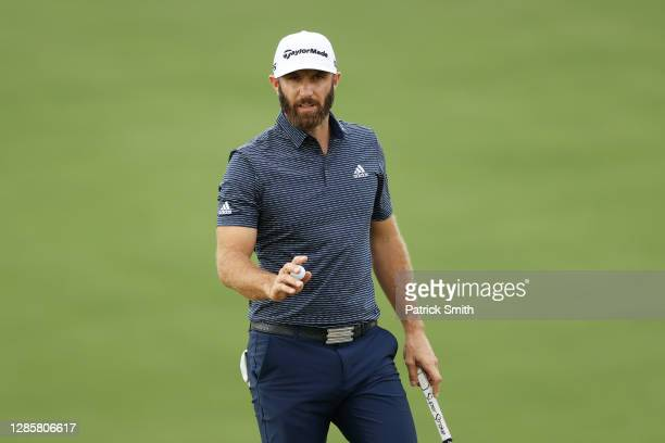 Dustin Johnson of the United States reacts after making a putt for par on the ninth green during the final round of the Masters at Augusta National...