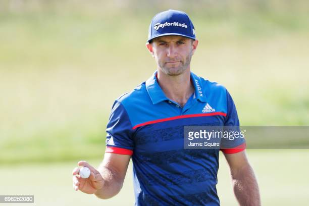 Dustin Johnson of the United States reacts after making par on the 11th green during the first round of the 2017 US Open at Erin Hills on June 15...