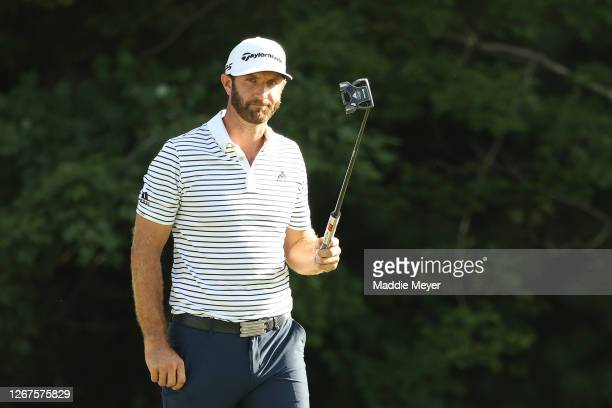 Dustin Johnson of the United States reacts after putting on the 18th hole to finish the day with a 60 during the second round of The Northern Trust...