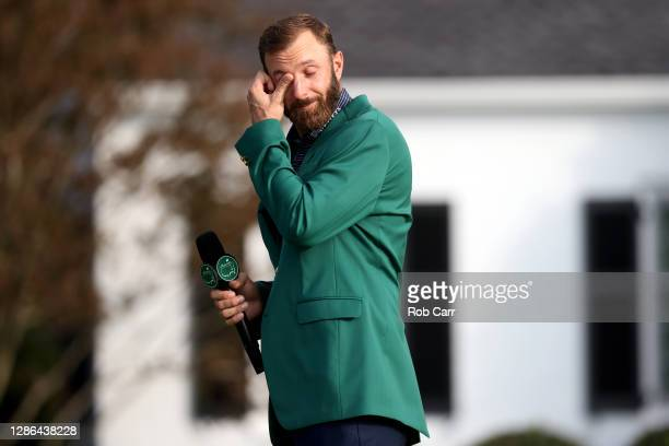Dustin Johnson of the United States reacts during the Green Jacket Ceremony after winning the Masters during the final round of the Masters at...