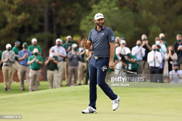 Dustin Johnson of the United States reacts on the 18th green after winning the Masters at Augusta National Golf Club on November 15, 2020 in Augusta,...