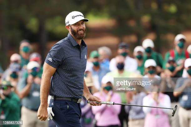 Dustin Johnson of the United States reacts on the 18th green after winning the Masters at Augusta National Golf Club on November 15 2020 in Augusta...
