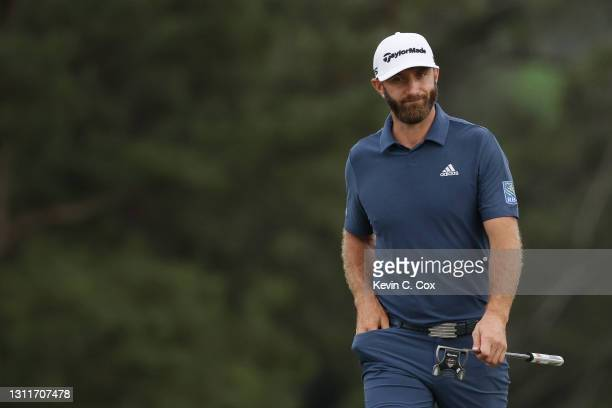 Dustin Johnson of the United States reacts on the 18th green during the second round of the Masters at Augusta National Golf Club on April 09, 2021...