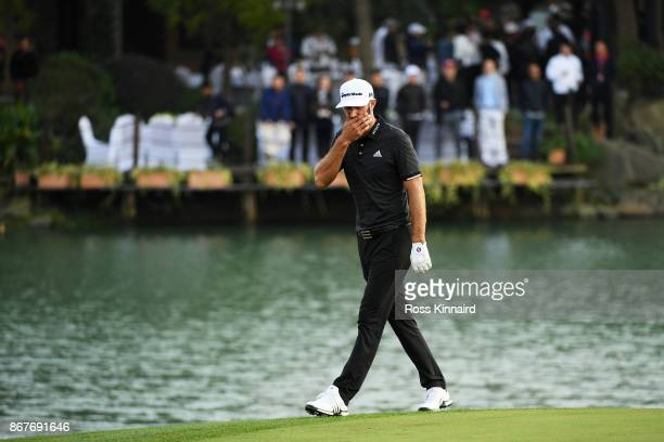 Dustin Johnson of the United States reacts on the 18th green during the final round of the WGC HSBC Champions at Sheshan International Golf Club on...
