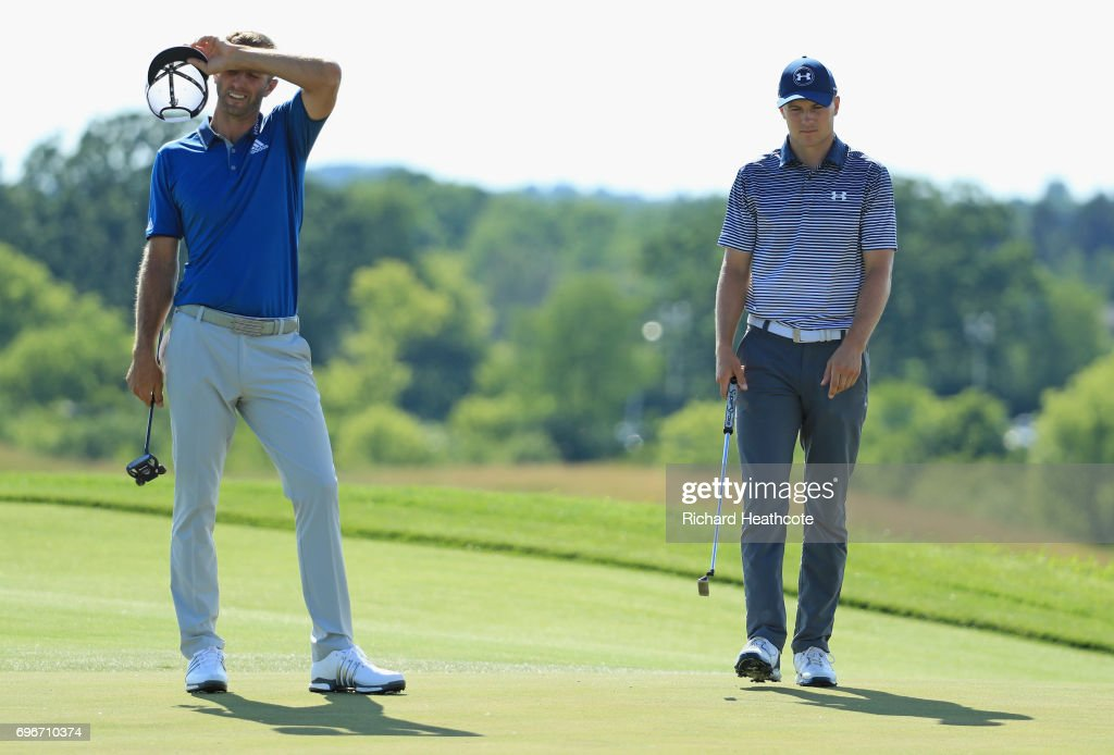 Dustin Johnson of the United States (L) reacts on the eighth green as Jordan Spieth of the United States looks on during the second round of the 2017 U.S. Open at Erin Hills on June 16, 2017 in Hartford, Wisconsin.