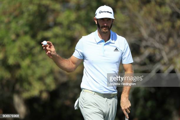 Dustin Johnson of the United States reacts on the first green during round two of the Abu Dhabi HSBC Golf Championship at Abu Dhabi Golf Club on...