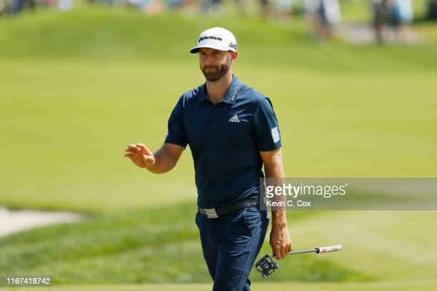 Dustin Johnson of the United States reacts on the seventh green during the final round of The Northern Trust at Liberty National Golf Club on August...