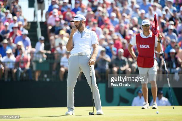 Dustin Johnson of the United States reacts to a bogey on the seventh green during the final round of the 2018 US Open at Shinnecock Hills Golf Club...