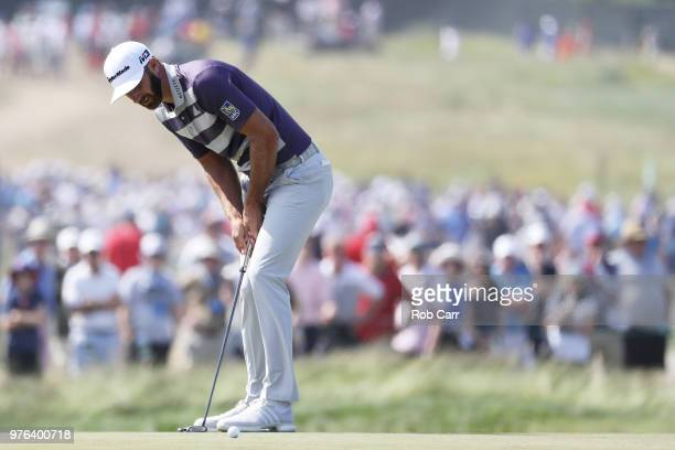 Dustin Johnson of the United States reacts to a missed putt for par on the fourth green during the third round of the 2018 US Open at Shinnecock...