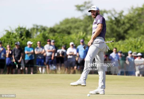 Dustin Johnson of the United States reacts to a missed putt on the sixth green during the third round of the 2018 US Open at Shinnecock Hills Golf...