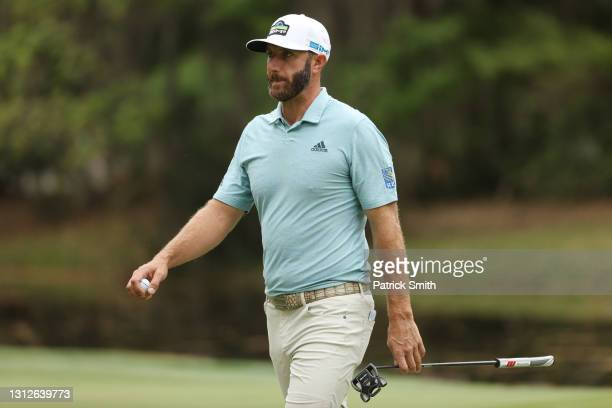 Dustin Johnson of the United States reacts to his birdie on the 14th green during the first round of the RBC Heritage on April 15, 2021 at Harbour...