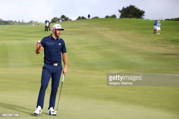 Dustin Johnson of the United States reacts to his eagle on the 12th green during the final round of the Sentry Tournament of Champions at Plantation...