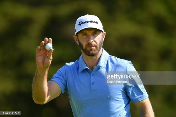 Dustin Johnson of the United States reacts to his putt on the 13th green during the second round of the 2019 PGA Championship at the Bethpage Black...