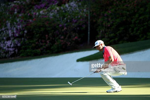 Dustin Johnson of the United States reacts to his putt on the 13th green during the final round of the 2016 Masters Tournament at Augusta National...
