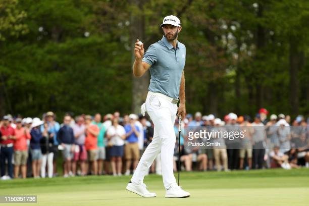 Dustin Johnson of the United States reacts to his putt on the fourth green during the final round of the 2019 PGA Championship at the Bethpage Black...