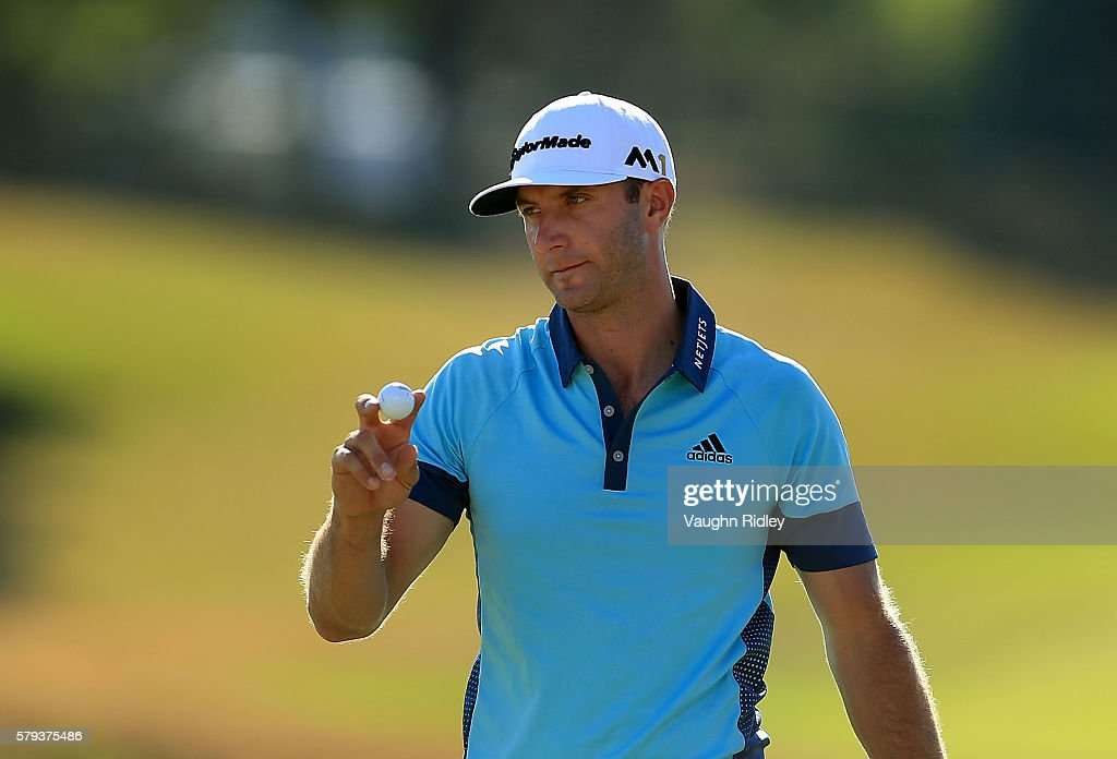 Dustin Johnson of the United States reacts to his putton the 18th green during the third round of the RBC Canadian Open at Glen Abbey Golf Club on July 23, 2016 in Oakville, Canada.