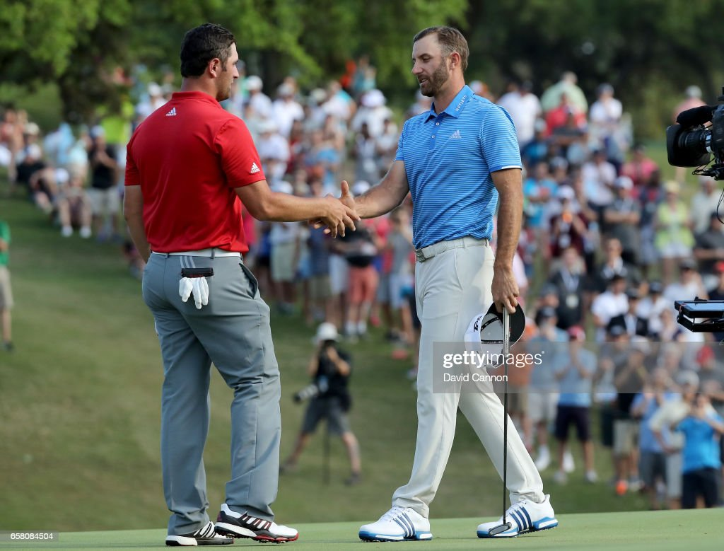 Dustin Johnson of the United States shakes hands with John Rahm of Spain (l) after hiw one hole win during the final of the 2017 Dell Match Play at Austin Country Club on March 26, 2017 in Austin, Texas.