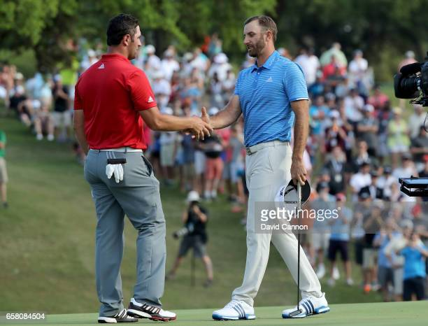 Dustin Johnson of the United States shakes hands with John Rahm of Spain after hiw one hole win during the final of the 2017 Dell Match Play at...