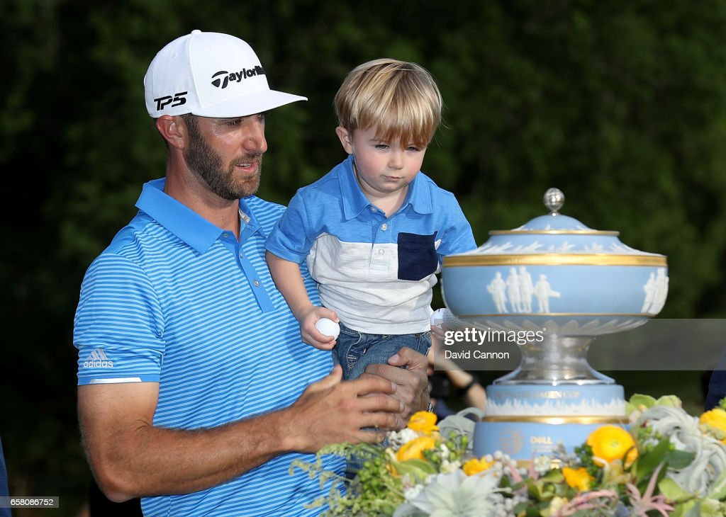 Dustin Johnson of the United States shows the Walter Hagen Trophy to his young son Tatum after his 1 up win in his match against John Rahm of Spain during the final of the 2017 Dell Match Play at Austin Country Club on March 26, 2017 in Austin, Texas.