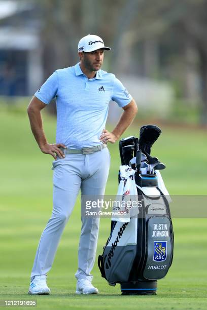 Dustin Johnson of the United States stands in the 10th fairway during the first round of The PLAYERS Championship on The Stadium Course at TPC...