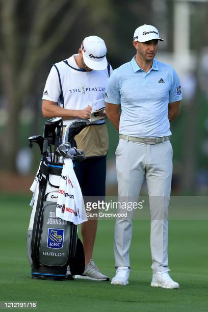 Dustin Johnson of the United States stands in the 11th fairway during the first round of The PLAYERS Championship on The Stadium Course at TPC...