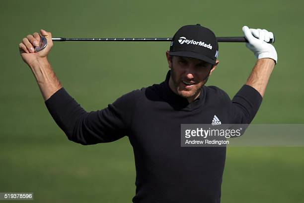 Dustin Johnson of the United States stands on the range during a practice round prior to the start of the 2016 Masters Tournament at Augusta National...