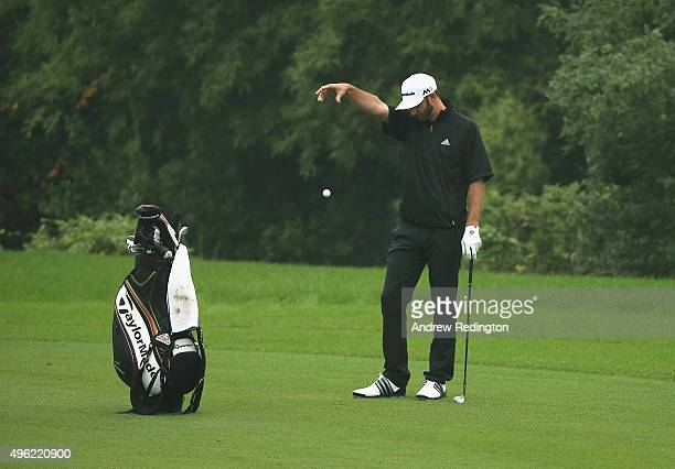 Dustin Johnson of the United States takes a drop after his ball ended up in the water on the eighth hole during the final round of the WGC HSBC...
