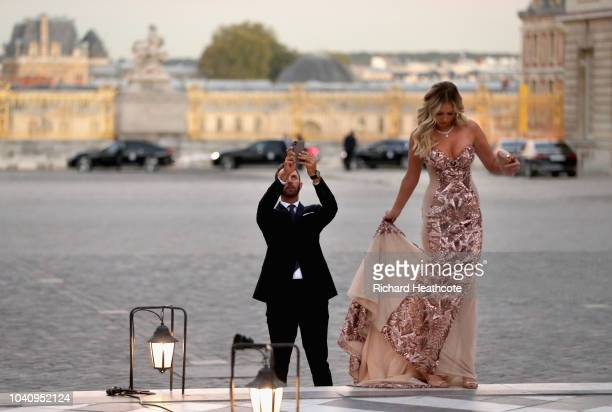 Dustin Johnson of the United States takes a picture of partner Paulina Gretzky before the 2018 Ryder Cup Gala dinner at the Palace of Versailles on...