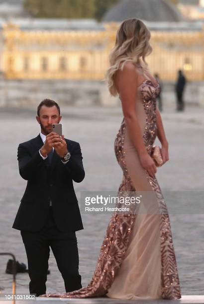 Dustin Johnson of the United States takes a picture of partner Paulina Gretzky before the Ryder Cup Gala dinner at the Palace of Versailles ahead of...