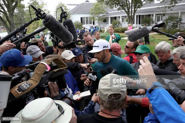 Dustin Johnson of the United States talks to the media announcing his withdrawl during the first round of the 2017 Masters Tournament at Augusta...