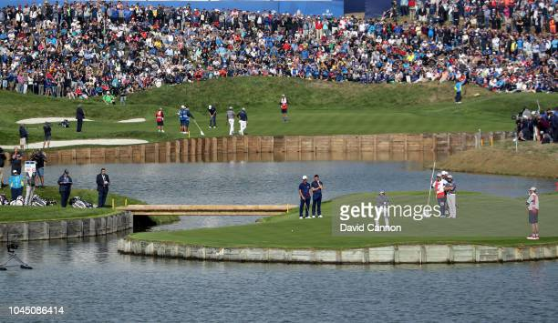 Dustin Johnson of the United States team just misses a putt on the 15th green in his match with Rickie Fowler against McIlroy and Olesen of the...