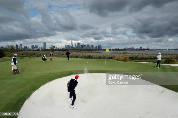 Dustin Johnson of the United States team plays his second shot on the 10th hole in his match with Brooks Koepka against Branden Grace and Marc...