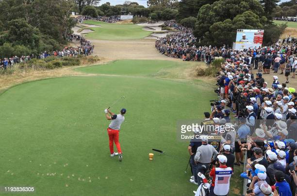 Dustin Johnson of the United States Team plays his tee shot on the par 3 third hole in his match with Gary Woodland in their match against Adam Scott...