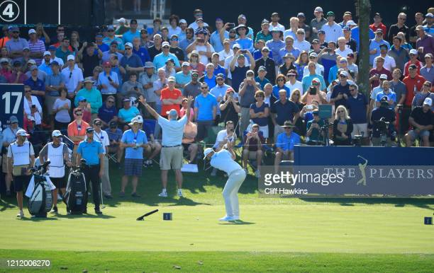 Dustin Johnson of the United States tees off on the 17th hole during the first round of The PLAYERS Championship on The Stadium Course at TPC...